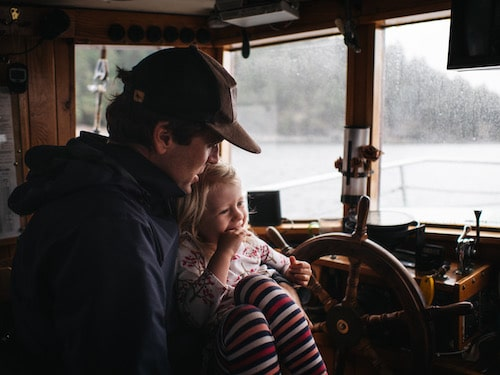 Jonas Fineman and his daughter on board the Misty Isles