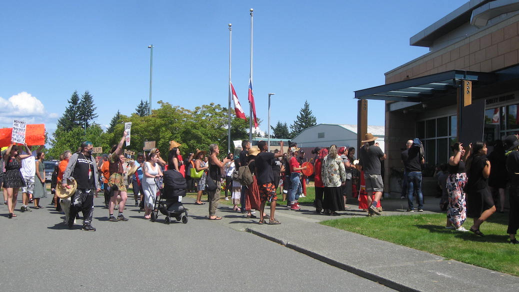 Crowd gathered in front of the RCMP building