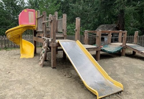 A playground, with slides and jungle gym,